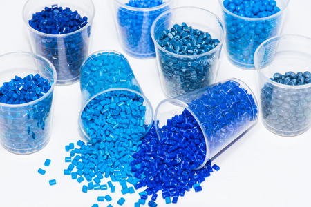 some blue dyed plastic polymer pellets in lab