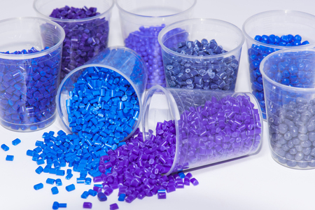 thermoplastic: some blue and violet dyed thermoplastic resin on white background Stock Photo