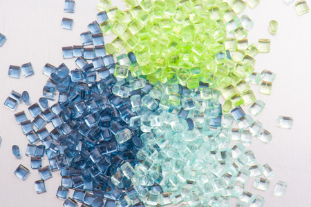 three different polymer plastic granulates on white background Archivio Fotografico