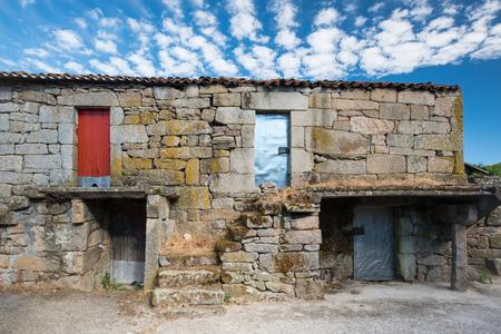 abandoned farmhouse abandoned farmhouse: facade of aged farmhouse in Galicia, Spain. Above: living area, underneath the stable.