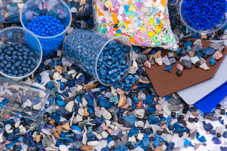 regrind of milled plastic goods with color samples and virgin material for recycling industry and plastic bag Stock Photo
