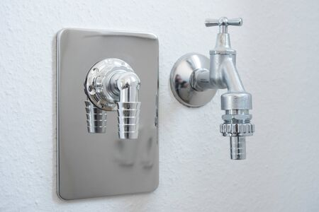 Water tap with hose connection for dish washer or washing machine