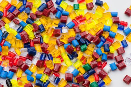 lot of different dyed plastic polymer resins for background