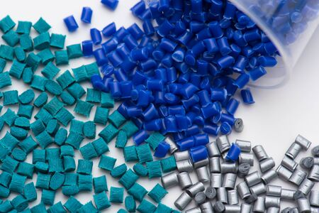 green glass-fibre reinforced, silver shiny non-reinforced and blue polymer plastic resin in lab