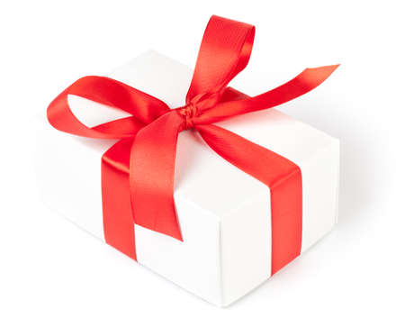 Gift box with red ribbon on white. This file is cleaned, retouched and contains clipping path.