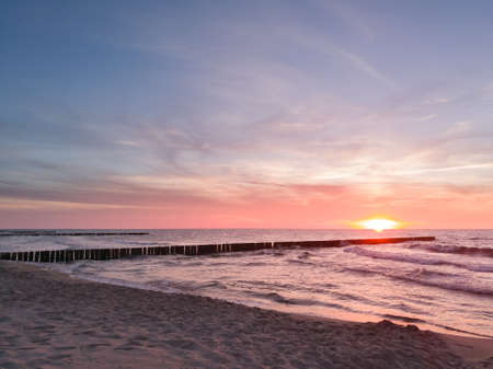 Baltic sea and sunset sky. This file is cleaned and retouched. Smartphone photo. 版權商用圖片