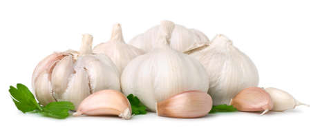 Garlic cloves on white. This file includes clipping path.