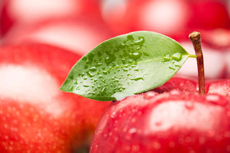 Close up of Red Apple with green leaf. This file is cleaned and retouched.
