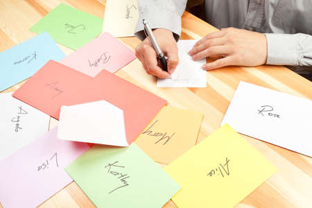 Man writing love letters to many women. This file is cleaned and retouched.