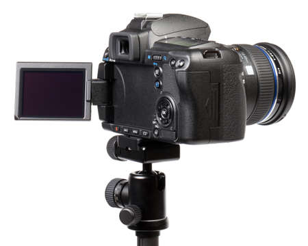 Digital camera on tripod. This file is cleaned, retouched and contains .