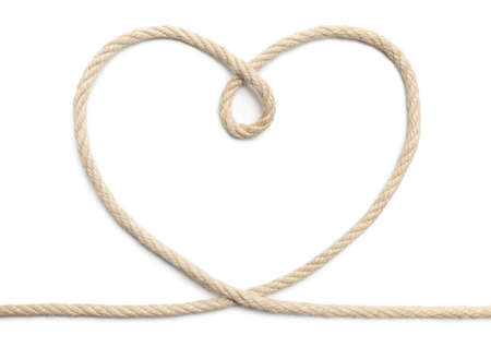 Close up of rope heart on white background. This file is cleaned, retouched and contains  . 版權商用圖片