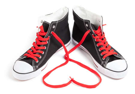 Hi-Top Black Sneakers  red laces heart on white. This file is cleaned, retouched and contains  .
