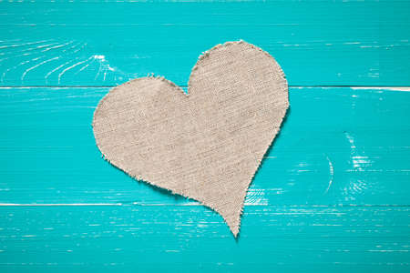 Linen heart on turquoise table. This file is cleaned and retouched. 版權商用圖片