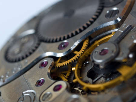 close up of old dusted clock gear