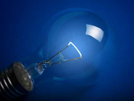 close up of light bulb on dark blue