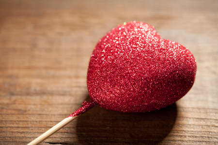Close up of glitter heart on old wooden table. This file is cleaned and retouched. Stock fotó