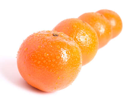 shot of tangerines with waterdrops on white background