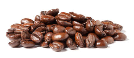 Close up of coffee beans on white background.