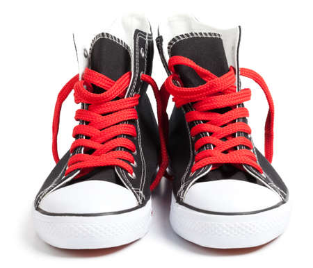 Hi-Top Black Sneakers with red laces on white. This file is cleaned, retouched and contains clipping path.