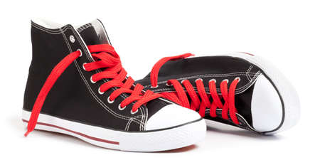Hi-Top Black Sneakers on white. This file is cleaned, retouched and contains clipping path. Banque d'images