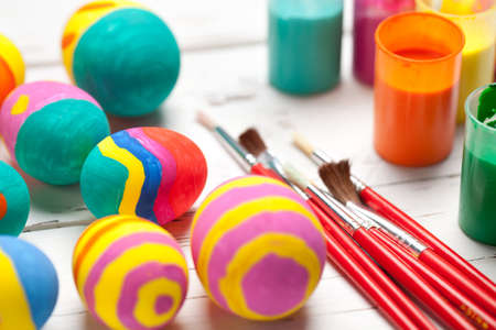 Colorful easter eggs on white table. This file is cleaned and retouched.