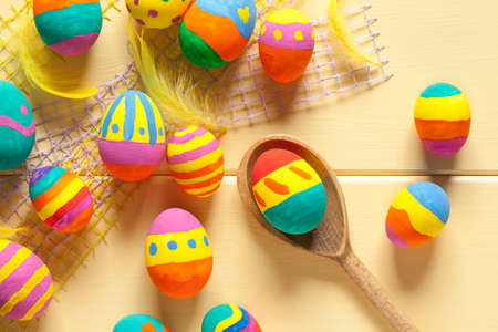 Colorful easter eggs on yellow wooden table. This file is cleaned and retouched. 版權商用圖片