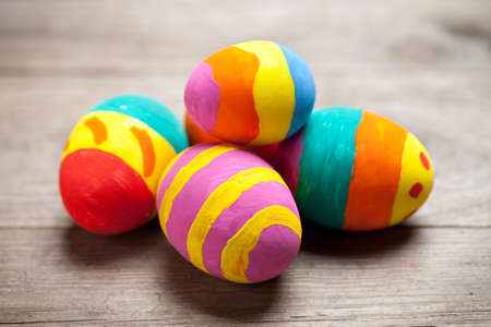 Colorful easter eggs on old wooden table. This file is cleaned and retouched. 版權商用圖片
