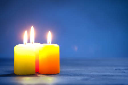 Colorful candles on dark blue background. On right is empty space to put text or something else. This file is cleaned and retouched. 版權商用圖片