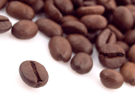 group of coffee beans on the white background