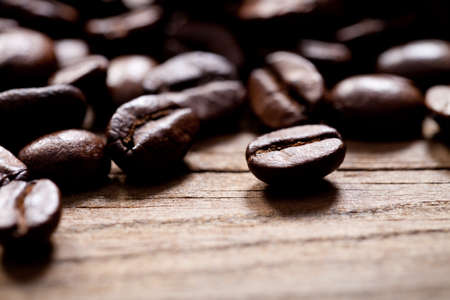 Close up of coffee beans on old wooden table. This file is cleaned and retouched. 版權商用圖片