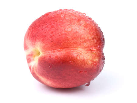fresh nectarine with water drops on white background