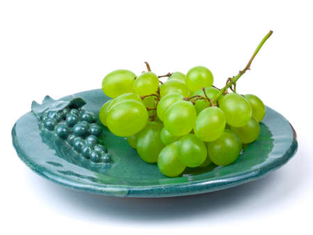 shot of bunch of grapes on green plate 版權商用圖片