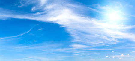 Panoramic blue sky with soft clouds and sun. This file is cleaned and retouched.