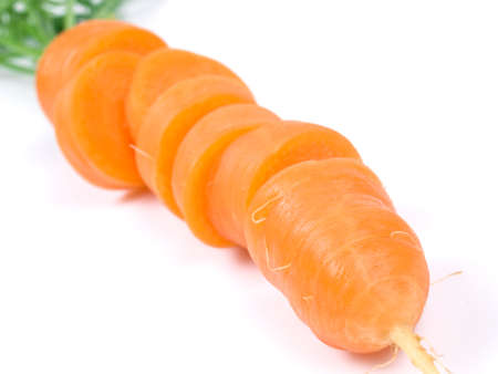 close-up of sliced fresh carrot on the white background 版權商用圖片