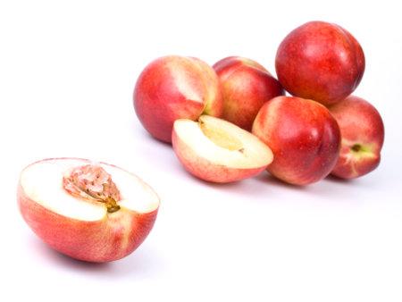 fresh sliced nectarine with stone on white background 版權商用圖片