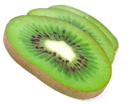 shot of fresh kiwi slices on white background