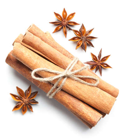 Anise stars and cinnamon sticks on white background. This file is cleaned, retouched and contains clipping path. Фото со стока