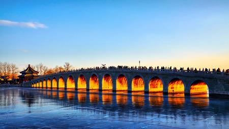 solstice: Winter solstice sunset Seventeen Arch Bridge Stock Photo