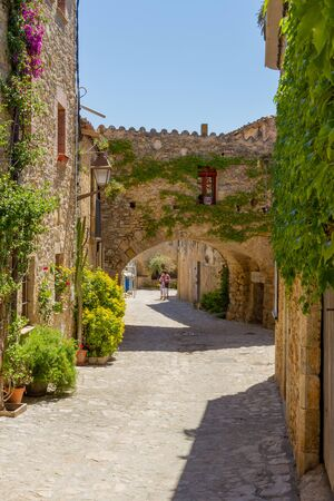 In the inland of Catelonia are very beautifull small and traditional vilages. Here a street with yellow stone houses and plants as decoration