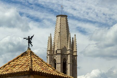 Wind vanes on top of building and tower
