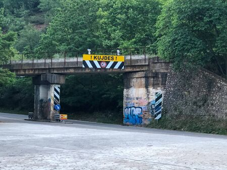 Warning for low bridge in Albania