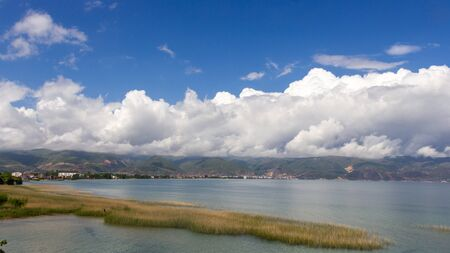 Pogradec under a beautiful blue sky with clouds