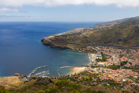 Beautiful view over the bay and harbor of Machico and the airport of Madeira