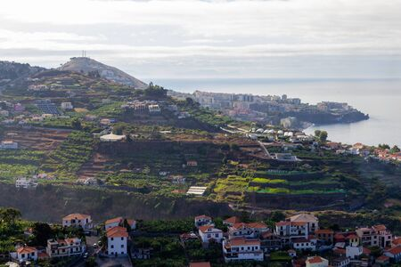 Green hill with houses along the coastline with good view 版權商用圖片