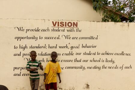MARIAMA KUNDA, GAMBIA- JAN 9, 2014: Schoolchildren standing before the vision of their school