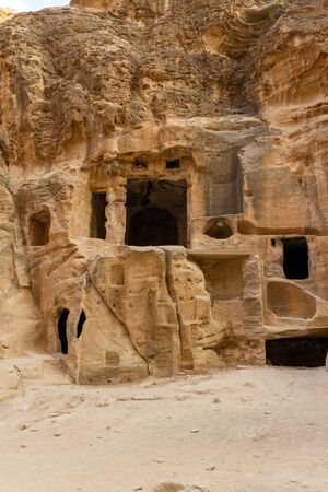 Siq al-Barid (aka Little Petra) is very near Petra. The buildings carved in stone are smaller and more simple then in Petra