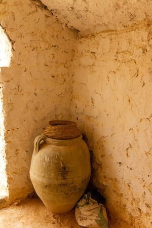 Stone jar in a traditional cave house in the desert of Tunisia