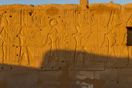Wall with hieroglyphs at the Karnak temple in Luxor