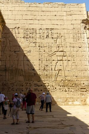 Hieroglyph wall at Medinet Habu, this is a large and well preserved temple in Luxor