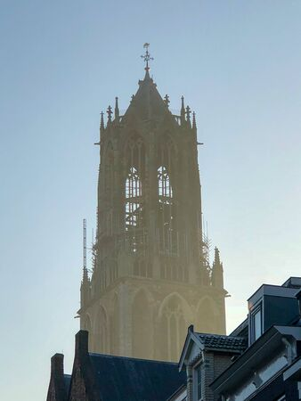 Closeup of the historical old Dom tower in beautiful light, early in the morning at sunrise